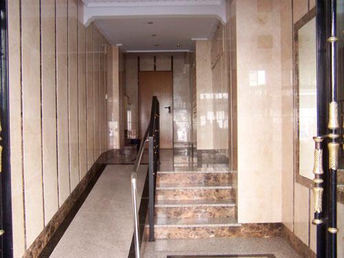 Portal mármol crema marfil y marrón emperador